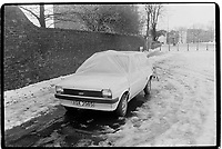 Ford protected against the weather with a sheet of plastic, Greenwich, London, 1982. South-East London, 1982