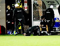 Fotball Tippeligaen 2015  01.11.2015<br /> Mjøndalen Stadion Isachsen Stadion<br /> <br /> Resultat 1 - 2<br /> <br /> Mjøndalen vs Ålesund<br /> <br /> Mjøndalen Trener Vegard Hansen  Ligger på bakken og Depper etter tap<br /> <br /> <br /> Foto: Robert Christensen Digitalsport