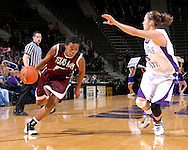 Texas A&M forward Danielle Gant (R) drives against pressure from Kansas State defender Shalee Lehning (R) in the first half at Bramlage Coliseum in Manhattan, Kansas, January 6, 2007.  K-State upset the 17th ranked Aggies 48-45.