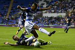 Reading's Andy Rinomhota and Millwall's Shane Ferguson in action