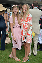 Left to right, KATIE READMAN and MARTHA WARD at the 2014 Glorious Goodwood Racing Festival at Goodwood racecourse, West Sussex on 31st July 2014.