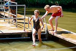 © Licensed to London News Pictures. 05/07/2017. London, UK. People swim in Hampstead Heath Mixed Bathing Pond in north London as temperatures hit 28C degrees on 5 July 2017. Photo credit: Tolga Akmen/LNP