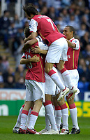 Photo: Daniel Hambury.<br />Reading v Arsenal. The Barclays Premiership. 22/10/2006.<br />Arsenal's Thierry Henry (hidden) is mobbed by team mates afdter scoring the first goal.
