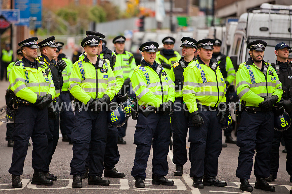 Luton, UK. 5th May, 2012. Police officers deployed to keep order between supporters of Unite Against Fascism attending the We Are Luton/Stop The EDL march from supporters of the far-right English Defence League. Around 1,500 police were deployed in Luton for the rival marches from twenty forces around the UK.