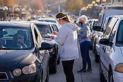06 NOVEMBER 2020 - DES MOINES, IOWA: People line up in their cars during a drive through emergency food distribution at the Iowa State Fairgrounds Friday. A spokesperson for the Food Bank of Iowa said they had enough food for 1,500 families. Each family got frozen chicken legs, frozen liquid eggs, and fresh produce. There will be another emergency food distribution at the Fairgrounds on November 30. Food insecurity in the Des Moines area has skyrocketed since the start of the Coronavirus pandemic. Although unemployment rates in Iowa have fallen since a peak in June, many families that fell behind on rent are now facing eviction. The food bank spokesperson said use of the Food Bank's emergency pantries and distribution points is still increasing.    PHOTO BY JACK KURTZ