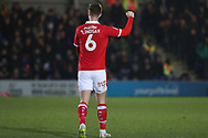 Barnsley defender Liam Lindsay (6) celebrating during the EFL Sky Bet League 1 match between AFC Wimbledon and Barnsley at the Cherry Red Records Stadium, Kingston, England on 19 January 2019.