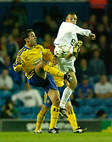 Photo. Jed Wee<br /> Leeds United v Southampton, FA Barclaycard Premiership, Elland Road, Leeds. 26/08/2003.<br /> Leeds' Jody Morris (R) and Southampton's Paul Telfer challenge for possession.