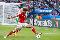 PARIS, FRANCE - Saturday, June 25, 2016: Wales' Hal Robson-Kanu in action against Northern Ireland's Jonathan Evans during the Round of 16 UEFA Euro 2016 Championship match at the Parc des Princes. (Pic by Paul Greenwood/Propaganda)