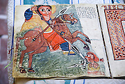 Illustrated Bible on display at Bete Maryam (House of Mary), a monolithic church carved from solid rock, in Lalibela, Ethiopia