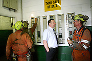 Vernon Watkins, 62, (right) is talking to project manager, Stuart Beaumont, appointed by Centechnology, the company working to restore Unity Mine and bring it to its full extraction capacity, (1 million tonnes a year) on Thursday, Apr. 12, 2007, in Cwmgwrach, Vale of Neath, South Wales. The time is ripe again for an unexpected revival of the coal industry in the Vale of Neath due to the increasing prize and diminishing reserves of oil and gas, the uncertainties of renewable energy sources, and the technological advancement in producing energy from coal while limiting emissions of pollutants, has created the basis for valuable investment opportunities and a possible alternative to the latest energy crisis. Unity Mine, in particular, has started a pioneering effort to revive the coal industry in the area, reopening after more than 8 years with the intent of exploiting the large resources still buried underground. Coal could be then answer to both, access to cheaper and paradoxically greener energy and a better and safer choice than nuclear energy as a major supply for the decades to come. It is estimated that coal reserves in Wales amount to over 250 million tonnes, or the equivalent of at least 50 years of energy supply, while the worldwide total coal could last for over 200 years as a viable resource compared to only a few decades of oil and natural gas.