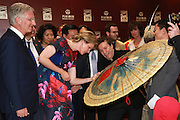 WUHAN, CHINA - JUNE 22: (CHINA OUT) <br /> <br /> King Philippe of Belgium Visits China<br /> <br /> Queen Mathilde of Belgium looks an oiled paper umbrella granted to her during her visiting the Han Show theater co-created by Wanda Group and Dragone that whose stage performance exceeds the level of any performance in the world with King Philippe (L) of Belgium on June 22, 2015 in Wuhan, Hubei Province of China. King Philippe of Belgium is on his visit to China with Queen Mathilde from June 21 to June 27.<br /> ©Exclusivepix Media