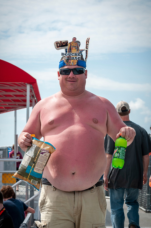 A sunburned NASCAR fan returns to his seat with a Mountain Dew and bag of popcorn at Bristol Motor Speedway in Tennessee on March 18, 2012.