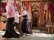 Women shop in the souq at the Old City, Damascus, Syria