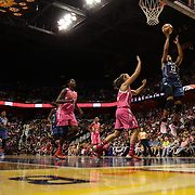 Maya Moore, (right), Minnesota Lynx, scores two points during the Connecticut Sun Vs Minnesota Lynx, WNBA regular season game at Mohegan Sun Arena, Uncasville, Connecticut, USA. 27th July 2014. Photo Tim Clayton
