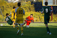 Hopkinton goalie Robbie Ferguson makes a save off a shot from Bow's Nikos Kalampalikis during Tuesday's NHIAA Division III Soccer.   (Karen Bobotas/for the Concord Monitor)