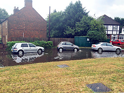 © London News Pictures. 28/07/2014. Hillingdon, UK. Flood water on long lane in Ickenham, London, which has been closed following flash flooding. Parts of the South of England experienced heavy rain and hail storms.. Photo credit : Michele Daryanani/LNP