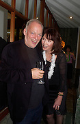Dave Gilmour and Carol Victor, Kathy Lette book launch, Savoy, swimming pool 12 November 2003. © Copyright Photograph by Dafydd Jones 66 Stockwell Park Rd. London SW9 0DA Tel 020 7733 0108 www.dafjones.com