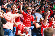 Charlton Athletic fans celebrate going 2-0 up during the EFL Sky Bet League 1 play off first leg match between Doncaster Rovers and Charlton Athletic at the Keepmoat Stadium, Doncaster, England on 12 May 2019.