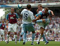 Photo: Tony Oudot. <br /> West Ham United v Manchester City. Barclays Premiership. 11/08/2007. <br /> West Hams Mark Noble clears the ball watched by Freddie Ljungberg