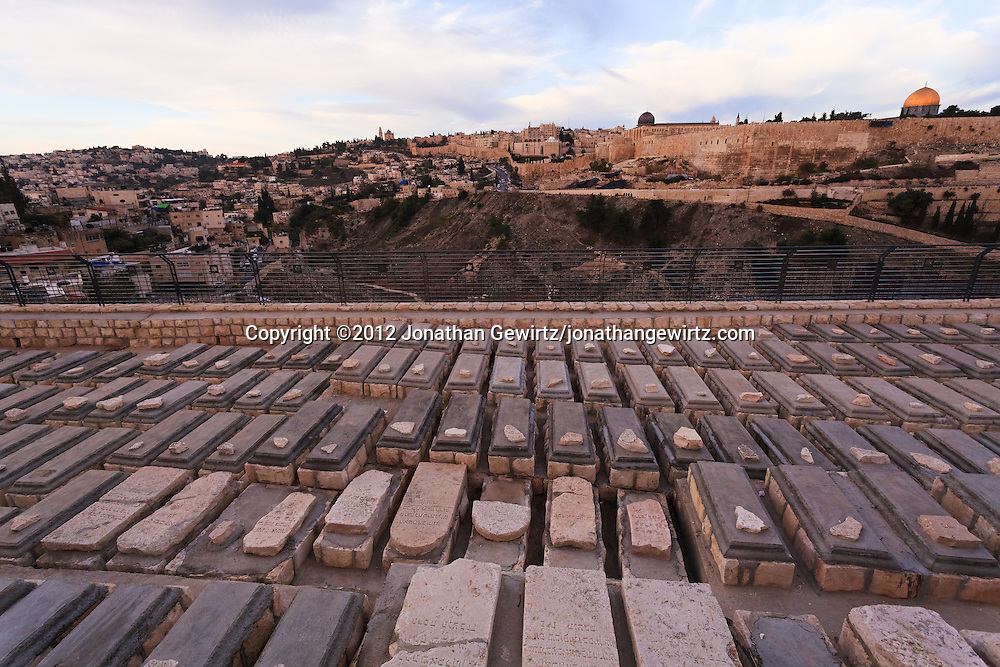 Restored graves in the Jewish cemetery on Jerusalem's Mount of Olives. The Jewish Quarter of the Old City of Jerusalem, Temple Mount and Dome of the Rock are visible in the background. WATERMARKS WILL NOT APPEAR ON PRINTS OR LICENSED IMAGES.