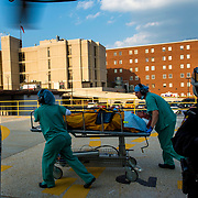 Nurses from MedStar DC hospital take take a vehicle accident victim into the hospital after being MedEvaced, June, 16 2014 in Washington D.C. The Maryland Aviation command provides, airborne law enforcement, search and rescue, and was the first civilian agency to transport a crucially injured patient by helicopter. These MedEvac services are provided free of charge to patients in the state of Maryland.(U.S. Air Force photo by Staff Sgt. Perry Aston/not reviewed)