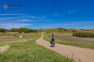 Bicycle touring along the Sheyenne Scenic Byway near Kathryn, North Dakota, USA