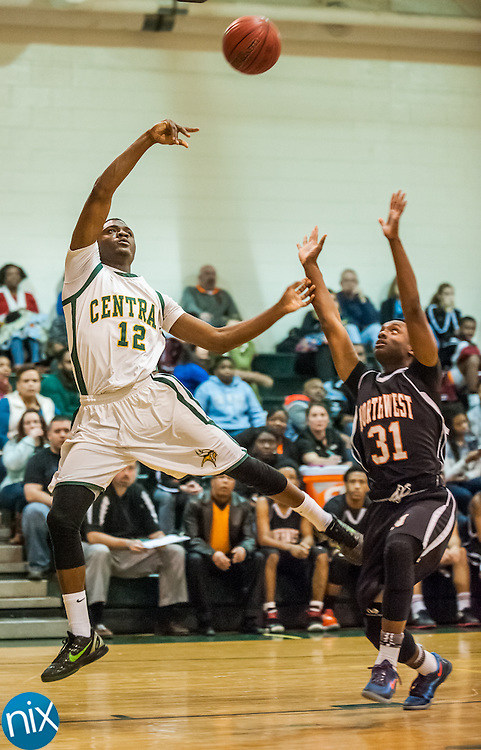 Central Cabarrus' Hasaan Klugh tosses up a shot against Northwest Cabarrus Friday night at Central Cabarrus High School. Central won the game 47-46.