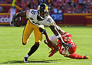 Wide receiver Martavis Bryant #10 of the Pittsburgh Steelers stiff-arms defensive back Marcus Peters #22 of the Kansas City Chiefs during the first half at Arrowhead Stadium in Kansas City, Missouri.