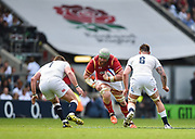 Wales' Jake Ball runs at England's Matt Mullan and Teimana Harrison during the The Old Mutual Wealth Cup match England -V- Wales at Twickenham Stadium, London, Greater London, England on Sunday, May 29, 2016. (Steve Flynn/Image of Sport)