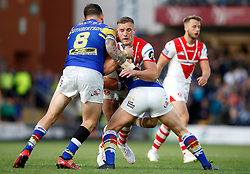 St Helens' Matty Lees is tackled by Leeds Rhinos Adam Cuthbertson (left) and Brad Dwyer during the Betfred Super League match at Headingley Stadium, Leeds.