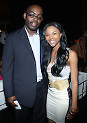 l to r: Earl Lucas and Courtney Heart at The Essence Music Festival Community Outreach Program held at The Ernest Morial Convention Center on July 2, 2009 in New Orleans, Louisiana
