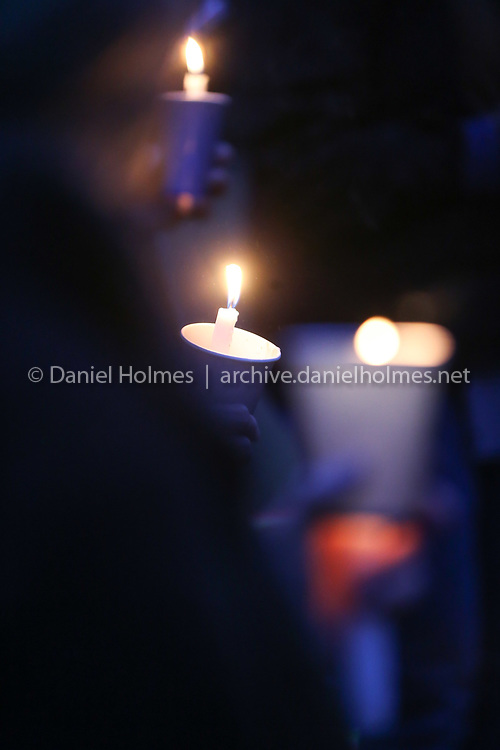 (12/14/19, HOLLISTON, MA) Participants light candles  during a candlelight vigil to remember victims of gun violence on the anniversary of the Sandy Hook Elementary School shooting at the First Congregational Church of Holliston on Saturday. [Daily News and Wicked Local Photo/Dan Holmes]