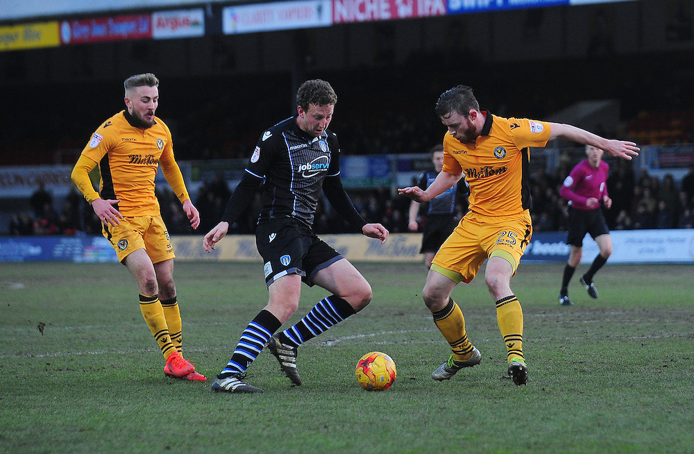 Colchester United's Tom Eastman under pressure from Newport County's Mark O'Brien<br /> <br /> Photographer Kevin Barnes/CameraSport<br /> <br /> The EFL Sky Bet League Two - Newport County v Colchester United - Saturday 14th January 2017 - Rodney Parade - Newport<br /> <br /> World Copyright © 2017 CameraSport. All rights reserved. 43 Linden Ave. Countesthorpe. Leicester. England. LE8 5PG - Tel: +44 (0) 116 277 4147 - admin@camerasport.com - www.camerasport.com