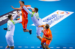 The Dutch handball player Jorn Smits in action against /s95, Nik Henigman from Slovenia during the European Championship qualifying match on January 6, 2020 in Topsportcentrum Almere