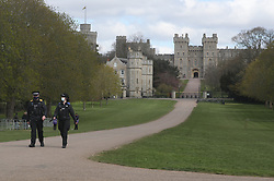 Police officers on the Long Walk at Windsor Castle, Berkshire, following the death of the Duke of Edinburgh at the age of 99 on April 10. Picture date: Thursday April 15, 2021.