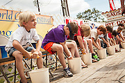 Young competitors race to husk the most corn at the World Grits Festival April 14, 2012 in St. George, SC. The festival celebrates the southern love for the sticky corn porridge