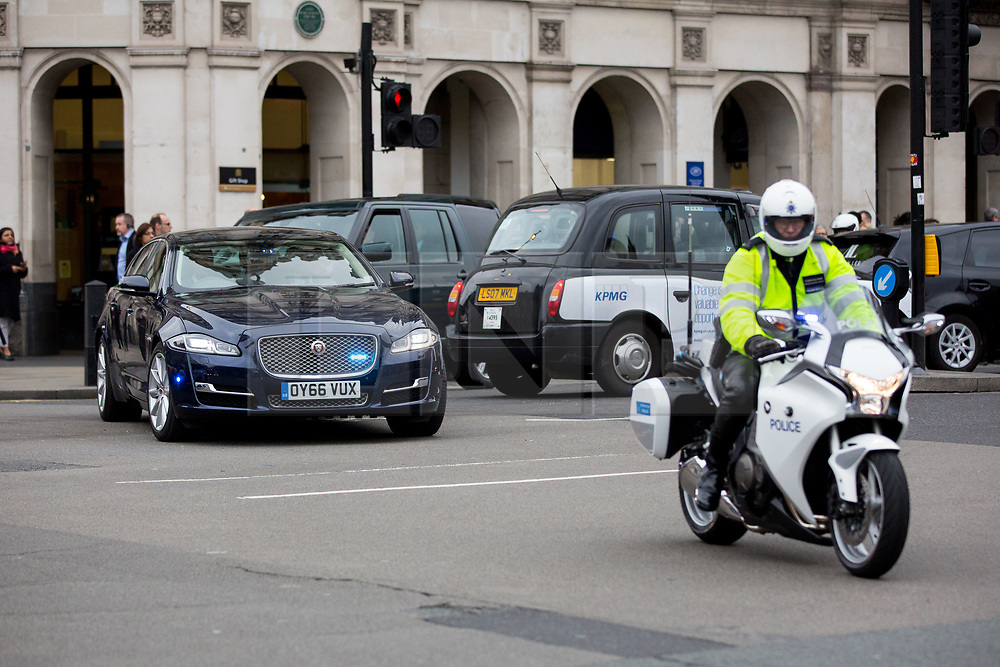 © Licensed to London News Pictures. 29/03/2017. London, UK. Chancellor of the Exchequer Philip Hammond drives through Westminster with Police convoy, as the triggering of Article 50 is due today. Photo credit : Tom Nicholson/LNP