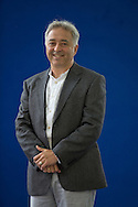Popular British children's writer Frank Cottrell Boyce, pictured at the Edinburgh International Book Festival where he talked about his latest book entitled 'The Race Against Time'. The three-week event is the world's biggest literary festival and is held during the annual Edinburgh Festival. The 2013 event featured talks and presentations by more than 500 authors from around the world and was the 30th edition of the festival.