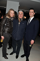 Left to right, JANE WINEHOUSE, MITCH WINEHOUSE and REG TRAVISS at a private view of Bill Wyman - Reworked held at the Rook & Raven Gallery, 7 Rathbone Place, London W1 on 26th February 2013.