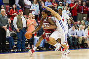 DALLAS, TX - NOVEMBER 25: Michael Qualls #24 of the Arkansas Razorbacks drives to the basket against the SMU Mustangs on November 25, 2014 at Moody Coliseum in Dallas, Texas.  (Photo by Cooper Neill/Getty Images) *** Local Caption *** Michael Qualls