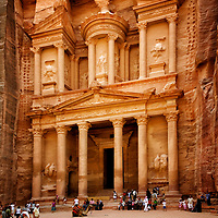 Petra. Jordan. View of the majestic and breathless Hellenistic elegant facade of the world famous Treasury building at the Red Rose city of Petra. The Treasury dates to around the 1st century BC and is believed to be commissioned by the Nabatean king Aretas III. The King was a lover of all things Greek and he brought architects from the Greek Mediterranean world to Petra to help craft the building. Carved out of solid rock, the building rises 43 meters high and was used as a royal tomb and not as a treasury. The vast city of Petra is the ancient home of the Kingdom of Nabataeans who settled here there more than two thousand years ago. It is a UNSECO world heritage listed site.