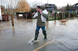 ©Licensed to London News Pictures 22/12/2019.<br /> Yalding ,UK. Residents carry sand bags to protect their houses in Yalding. The River Medway and River Beult have bursts their banks causing severe flooding in Yalding village, Kent. Photo credit: Grant Falvey/LNP