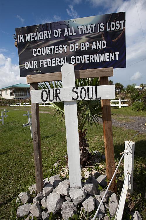 Anti-Bp sign, BP oil leak, BP oil spill, British Pretroleum, Grand Isle, Louisiana, USA, america, barrataria Bay, crosses, environmental disaster, graveyard, new orleans, oil and gas industry, oil on beach, symbolic graveyard