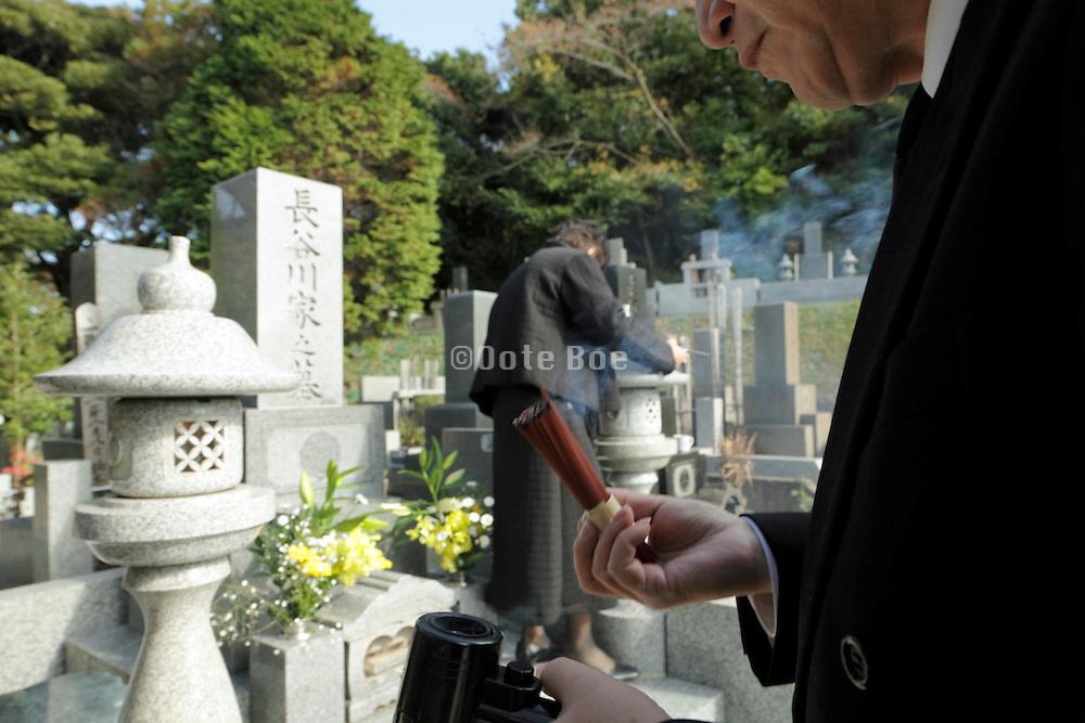 burning incense for offering Japan