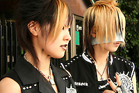 """Harajuku Goths.  A wide variety of """"costume play"""" getups are shown here: goths, cartoon characters from Japanese manga, anime,  the sweet-and-innocent frilly look or combinations in between (goth lolly)  Every Sunday, these cosplay characters converge on Harajuku, Tokyo's fashion quarter. Most casual observers say that cosplay is a reaction to the rigid rules of Japanese society. But since so many cosplay girls congregate in Harajuku and Aoyama - Tokyo headquarters of Fendi, Hanae Mori and Issey Miyake, others consider it is a reaction to high fashion. Whatever the cause, cosplay aficionados put a tremendous amount of effort into their costumes every Sunday. One wonders what they wear on Monday morning..."""