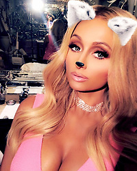 """Paris Hilton releases a photo on Instagram with the following caption: """"Meow \u2728\ud83d\udc95\ud83d\udc95\ud83d\udc31\ud83d\udc95\ud83d\udc95\u2728"""". Photo Credit: Instagram *** No USA Distribution *** For Editorial Use Only *** Not to be Published in Books or Photo Books ***  Please note: Fees charged by the agency are for the agency's services only, and do not, nor are they intended to, convey to the user any ownership of Copyright or License in the material. The agency does not claim any ownership including but not limited to Copyright or License in the attached material. By publishing this material you expressly agree to indemnify and to hold the agency and its directors, shareholders and employees harmless from any loss, claims, damages, demands, expenses (including legal fees), or any causes of action or allegation against the agency arising out of or connected in any way with publication of the material."""
