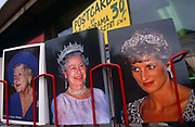 Two queens and one princess, members of the British royal family are depicted on a postcard rack in central London.  On the left is Queen Elizabeth (known as the Queen Mother (born Bowes-Lyon) who died at the age of 101 in 2002. Her daughter is the present Queen Elizabeth the second and to her right is Princess Diana, the Princess of Wales who died tragically in Paris in 1997. The three are seen on sale outside a tourist shop in Whitehall in the borough of Westminster where revenue-earning foreign holidaymakers frequent to see major landmark sites such as Parliament and Buckingham Palace. While the Queen wears a formal crown, the Princess is with a tiara and all three are on sale for 30 pence (£0.3)