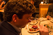 New York, NY, Sept. 30, 2013. Grant Reynolds, wine director at Charlie Bird. Diner David Beckwith samples a wine.
