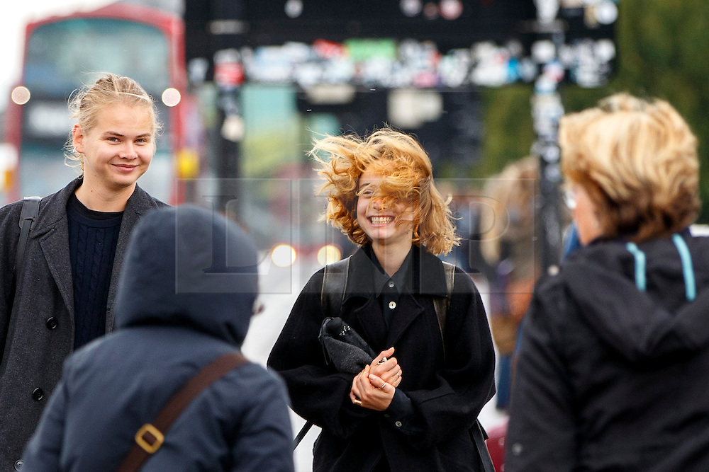 © Licensed to London News Pictures. 26/08/2015. London, UK. People crossing Waterloo Bridge during heavy rain in central London on Wednesday, August 26, 2015. Photo credit: Tolga Akmen/LNP