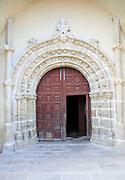 Traditional architecture arched doorway village church,  Cuacos de Yuste, La Vera, Extremadura, Spain